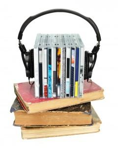 bigstock_Stack_of_CDs_with_HI-Fi_headph_12366542